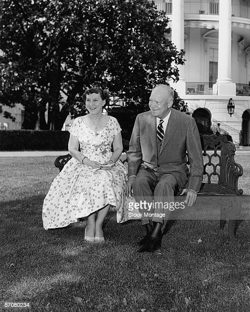 38th wedding anniversary portrait of Mamie and Dwight D Eisenhower the American First Lady and President as they sit on a bench on the lawn of the...
