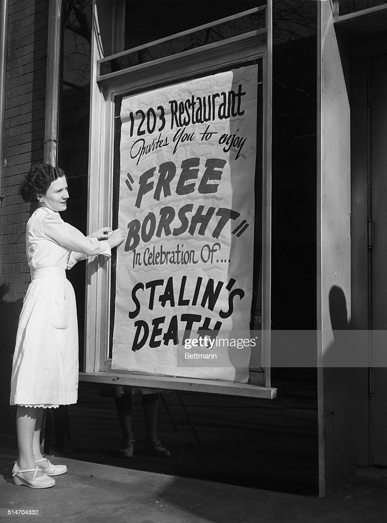 Eileen Keenan, a waitress at the 1203 Restaurant, puts up a sign outside the restaurant, March 6, inviting everyone to enjoy 'Free Borst' in celebration of Stalin's death.