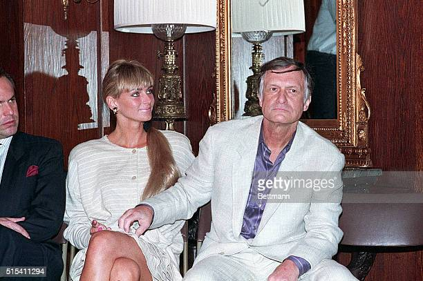 3/9/1988Los Angeles California Hugh Hefner tickles the leg of his latest significant other Kimberly Conrad who was Playboy's centerfold before...