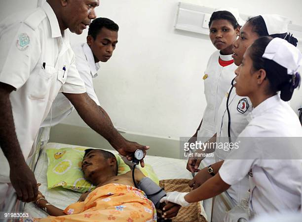 Year-old man receives treatment for tropical malaria in hospital on October 13, 2009 in Manokwari, West Papua, Indonesia. Malaria, whilst not a new...