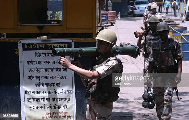 Armed Indian security officers patrol outside the special court set up for the trial of of Mohammad Ajmal Kasab the lone surviving gunman of the...