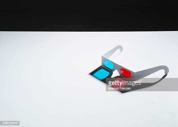 3d glasses on white surface