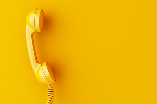 3d phone reciever on yellow background. 1035672660