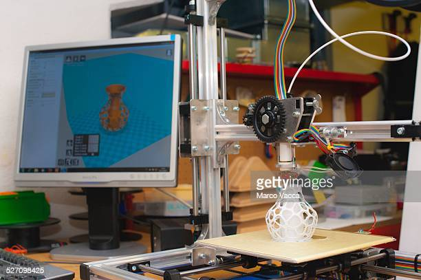A 3d printer at work at Polytechnic university in Milano producing a model of a small vase