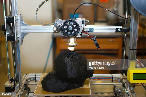A 3d printer at work at polytechnic university in Milano producing a mock up of a real space rock