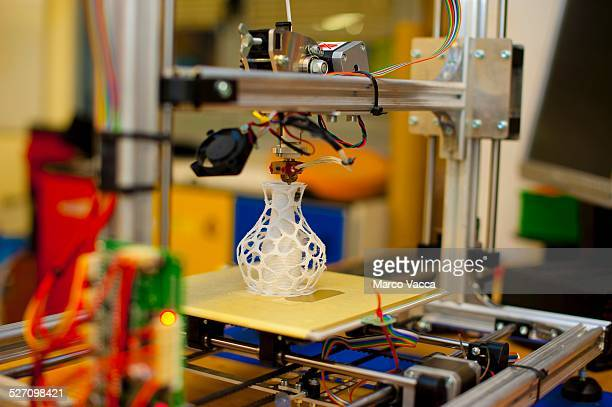 A 3d printer at work while producing a small scale model of a vase at Politecnic labs in Milano Italy
