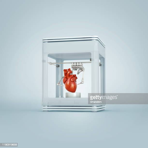 3d printer printing a heart - man made object stock pictures, royalty-free photos & images
