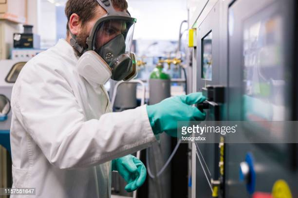 3d printing: scientist work on a slm machine (selective laser melting) for metal - gas mask stock pictures, royalty-free photos & images