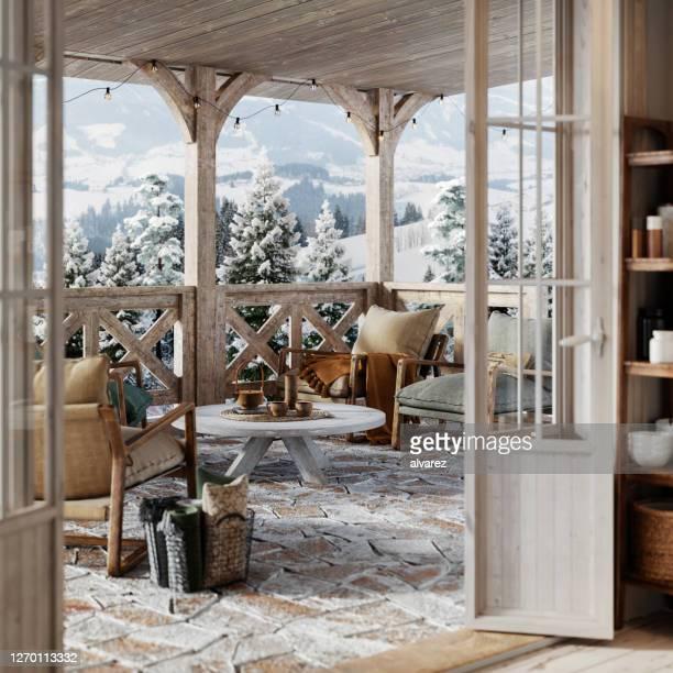 3d render de un balcón en la casa de invierno nevada - cabaña fotografías e imágenes de stock