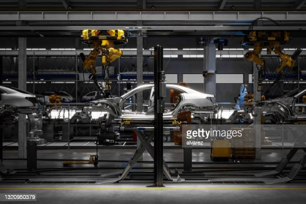 3d render of a car on robotic welding line - making stock pictures, royalty-free photos & images