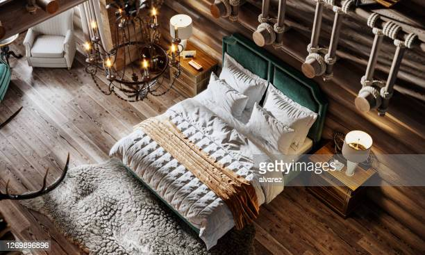 3d render of luxurious interior of a bedroom in cottage - hotel stock pictures, royalty-free photos & images