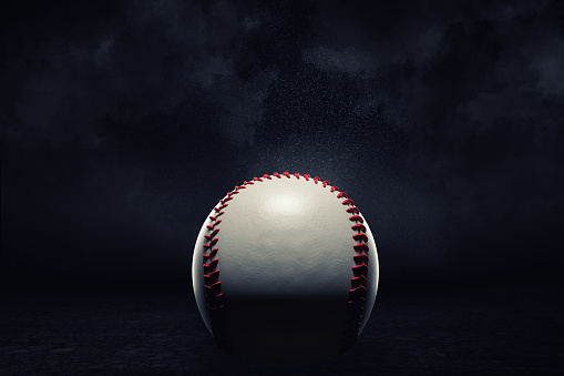 3d rendering of a single baseball ball in a close view under a spotlight on a dark background. 1053100208