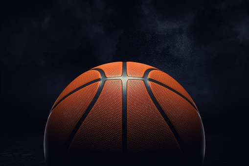 3d rendering of an orange rubber surface of a basketball ball shown on a black background. 1055943290