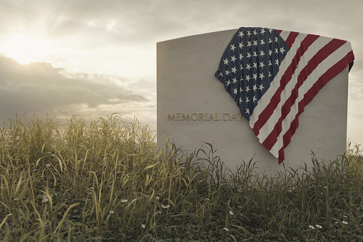 3d rendering of close up American flag laying on grave at the peaceful flower meadow to remember the memorial day 1150596733