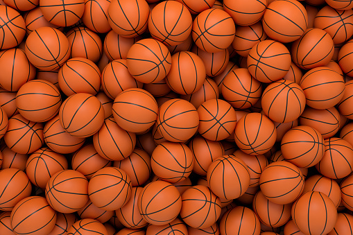 3d rendering of many orange basketball balls lying in an endless pile seen from the top. 1049442900