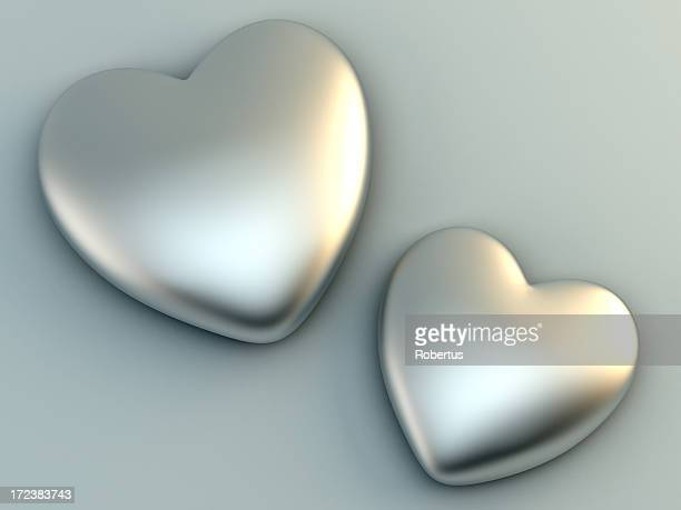 3d rendering of two beautiful steel hearts