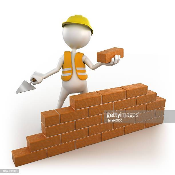 3d workman building brick wall, isolated w. clipping path