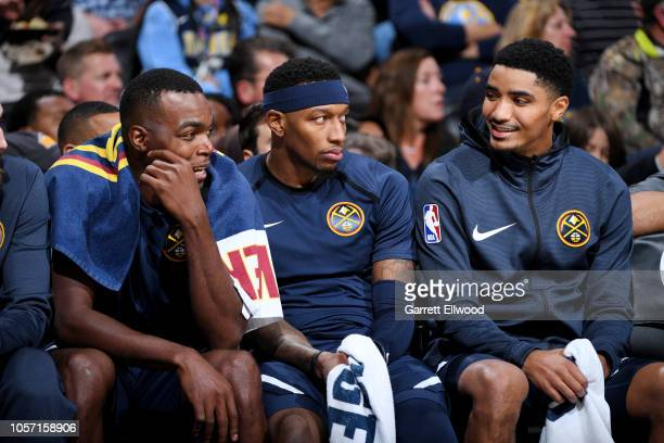 Denver Nuggets players share a laugh on the bench during the game against the Utah Jazz on November 3, 2018 at the Pepsi Center in Denver, Colorado....