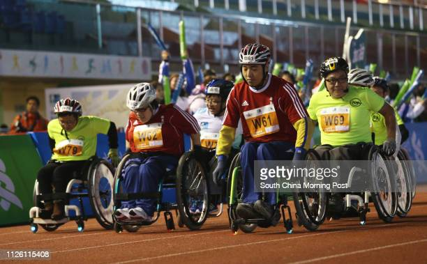 3km Wheelchair race take action during Standard Chartered Hong Kong Marathon 2014 Picture shows racers at the starting point in Wan Chai Sport Ground...