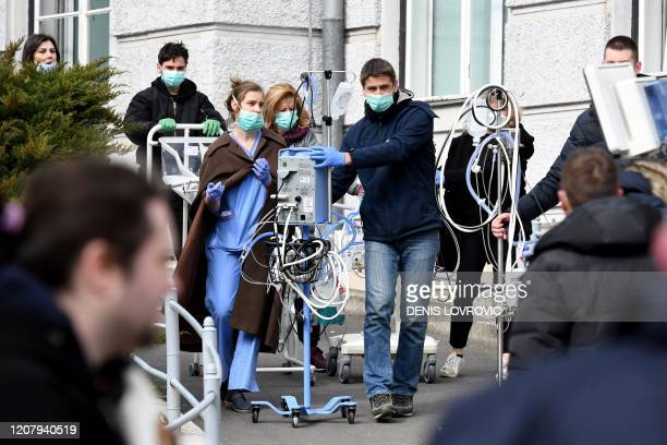 TOPSHOT Medical staff and volunteers evacuate a maternity hospital in Zagreb on March 22 after an earthquake hit the country at 0600 am A 53magnitude...
