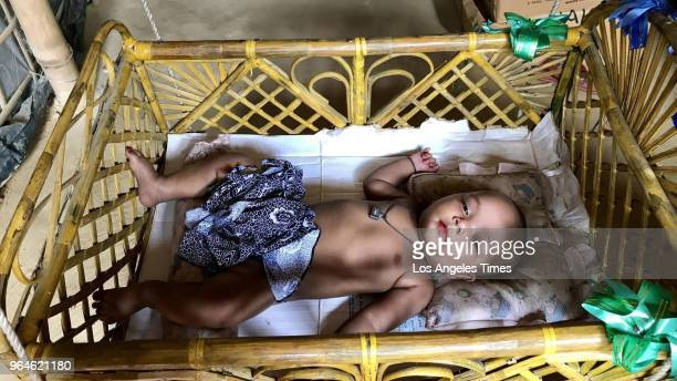 A 3monthold girl Samira rests in the Kutupalong refugee camp in Bangladesh Her mother a Rohingya Muslim was gangraped by Myanmar soldiers