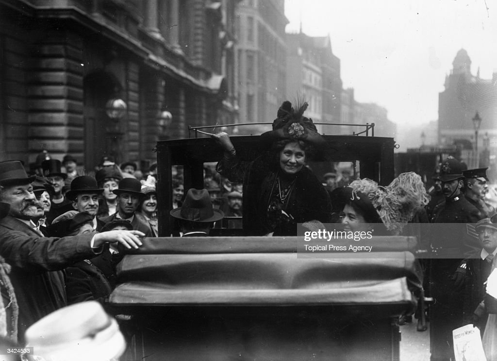The English suffragette Emmeline Pankhurst (1858 - 1928) (centre), founder with her daughter Christabel (right) of the Women's Social and Political Union, leaves Bow Street police station on being granted bail. Pankhurst was frequently imprisoned, and underwent hunger strikes and forcible feeding.
