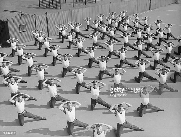 Soldiers doing floor exercises at the Army School of Physical Training Aldershot