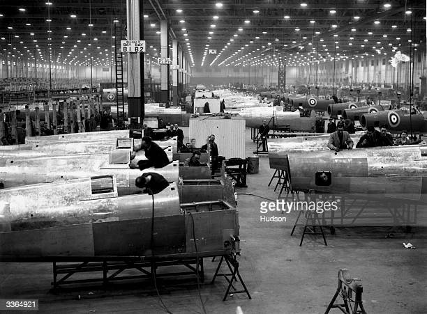 Workers in the assembly area of an aircraft factory in the Midlands building spitfires