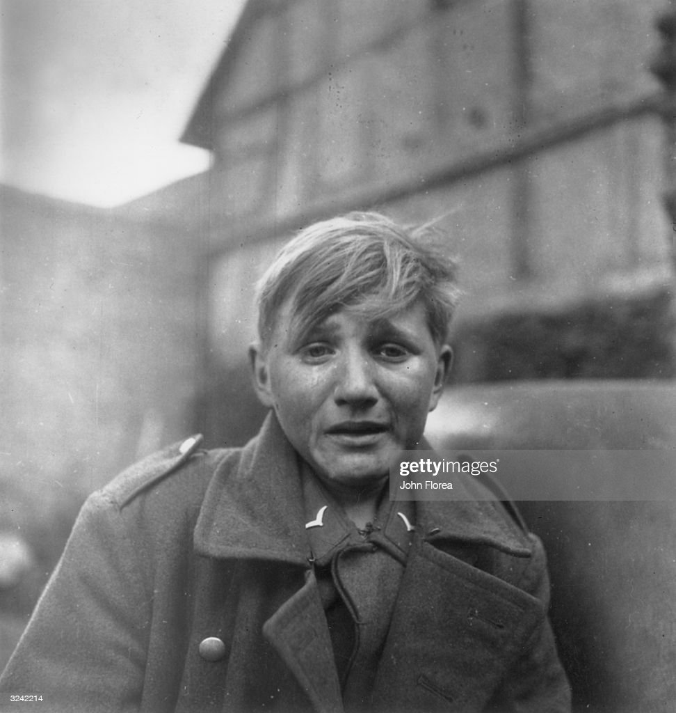 A fifteen year old German soldier, Hans-Georg Henke, cries tears of defeat after being captured by the US 9th Army in Germany.