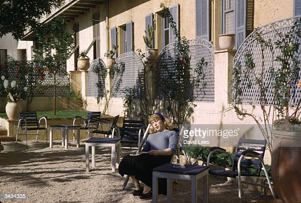 Roberta Cowell, formerly Robert Cowell resting outside her hotel in the south of France. Roberta was once a Spitfire pilot, prisoner-of-war, racing...