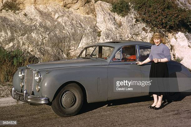 Roberta Cowell, formerly Robert Cowell standing beside her car in the south of France. Roberta was once a Spitfire pilot, prisoner-of-war, racing...