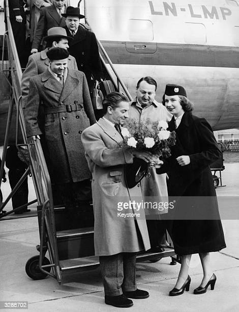 Herbert Von Karajan the Austrian conductor arriving at Hanover airfield after his American tour with the Berlin philharmony orchestra