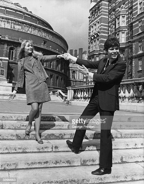 British singer Cliff Richard with the Belgian singer Claude Lombard outside the Royal Albert Hall London Both singers are due to represent their...