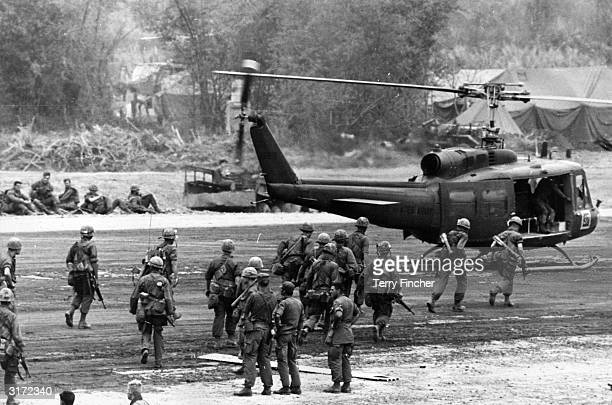 US 'air cavalry' moves toward a US Army assault helicopter which will take part in securing a landing zone two miles from Khe Sanh during the Vietnam...