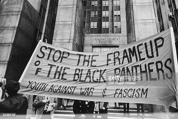 Banner protesting the incarceration of Black Panthers members outside Criminal Courts Building, New York City. The protesters were demanding the...