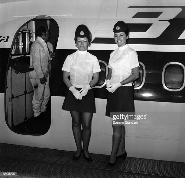 Air hostesses at work just before welcoming boarding passengers onto the plane