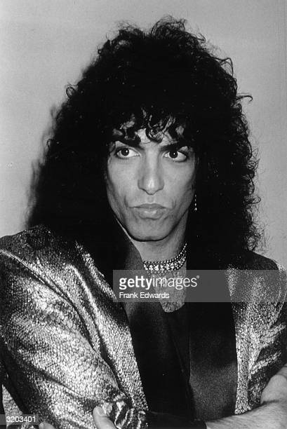 Headshot of American singer Paul Stanley, a.k.a. Star Lover, of the rock group Kiss, with his lips pursed and his arms folded in front of his chest...