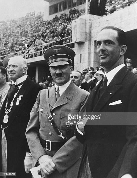 German dictator Adolf Hitler standing with Italian Crown Prince Umberto watching the Olympic Games in Berlin