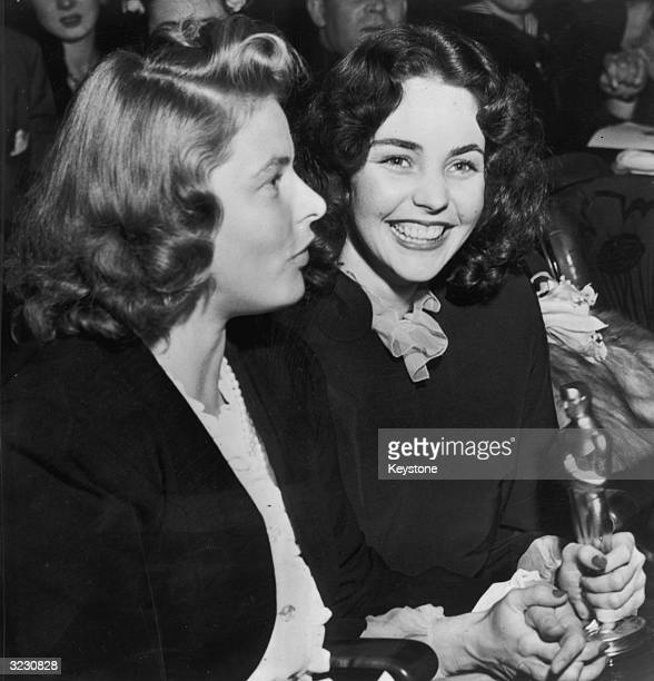 American actress Jennifer Jones with the Best Actress Oscar she won for her performance in 'Song of Bernadette' She is with Swedish film star Ingrid...