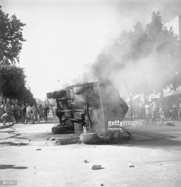 A burning RAF truck which was overturned and set alight during disturbances in Allenby Road Tel Aviv