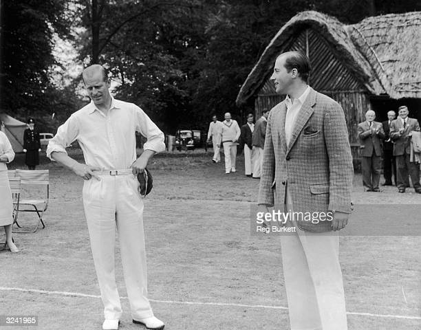 Lord Porchester tossing up with the Duke of Edinburgh before leading his team onto the field for a cricket match.