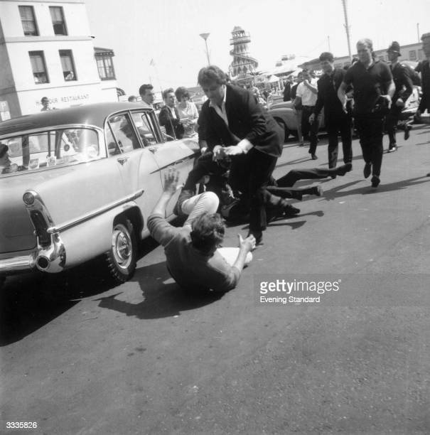 Mods and Rockers fighting in the streets of hastings Kent