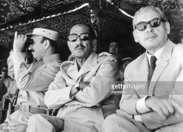 President Anwar alSadat of Egypt flanked by General L Mohammed Ahmed Sadek and Hussein El Chafel watching manoeuvres carried out by the Egyptian...