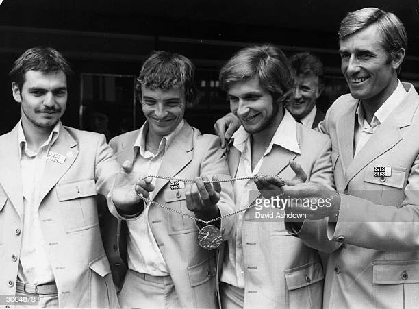 From left to right Olympic pentathletes Danny Nightingdale Adrian Parker Andy Archibald and Sergeant Jim Fox return in triumph from the Montreal...