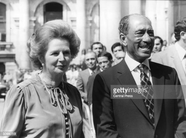 British Conservative Prime Minister Margaret Thatcher walks the streets of London with Egyptian President Mohammed Anwar al Sadat