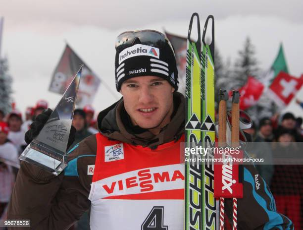 3rd Dario Cologna of Switzerland celebrates his success during the final climb men for the FIS Cross Country World Cup Tour de Ski on January 10 2010...