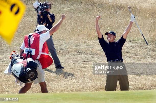 GEORGES 3rd DAY TIGER WOODS AFTER CHIPING IN FROM A BUNKER ON THE 7th FOR EAGLE 19/7/2003