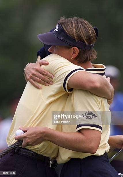 Charlotta and Annika Sorenstam of Sweden hug one another after the last round of the Womens World Cup of Golf the Australian pair of Karrie Webb and...