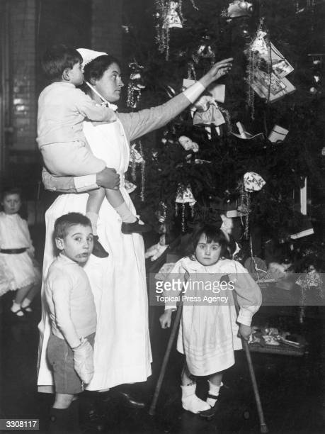Nurse and patients at a Christmas party at Great Ormond Street Hospital for Sick Children London