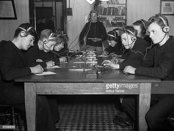 Cadets at the Nautical School at Heswall, Cheshire, practicing Morse code in one of the model ships specially built for training on the premises.